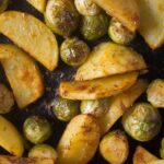 tender potato slices and brussels sprouts close up
