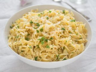 garlic butter noodles with parmesan in a white serving bowl