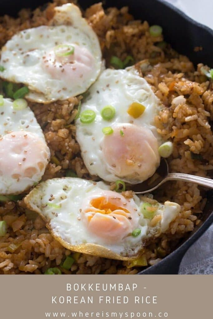 cast iron skillet full of fried rice with eggs on top