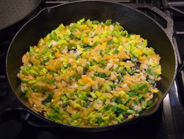 frying rice, kimchi and vegeatbles in a skillet