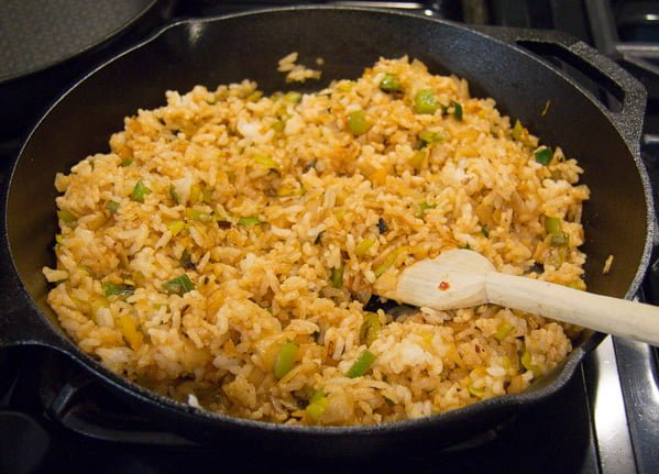 step by step making fried rice in a cast iron skillet