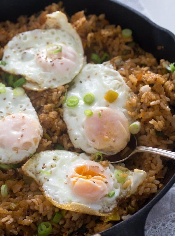 full skillet with fried rice and four fried eggs