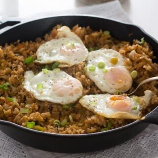 bokkeumbap with kimchi and eggs in a cast iron skillet