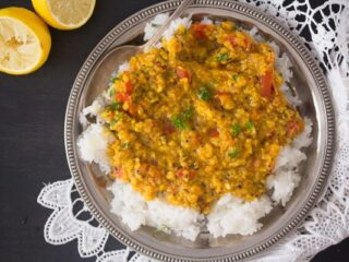indian moong dal in a bowl with rice