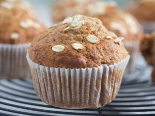 honey oat banana muffins on a wire rack