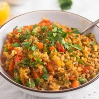 vegetarian buckwheat with peppers and carrots in a bowl.