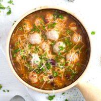 bratwurst soup in a small earthen pot.