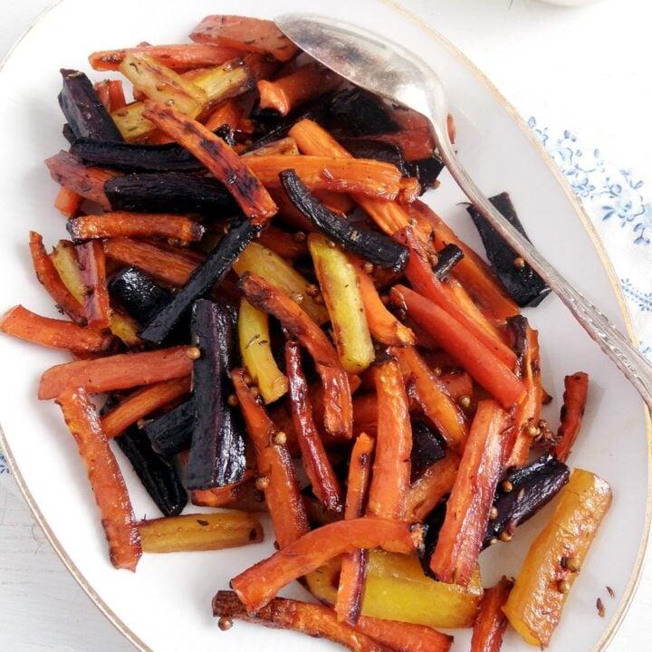 rainbow carrots glazed with honey on a platter