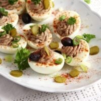 romanian deviled eggs with olives and sprinkled with paprika.