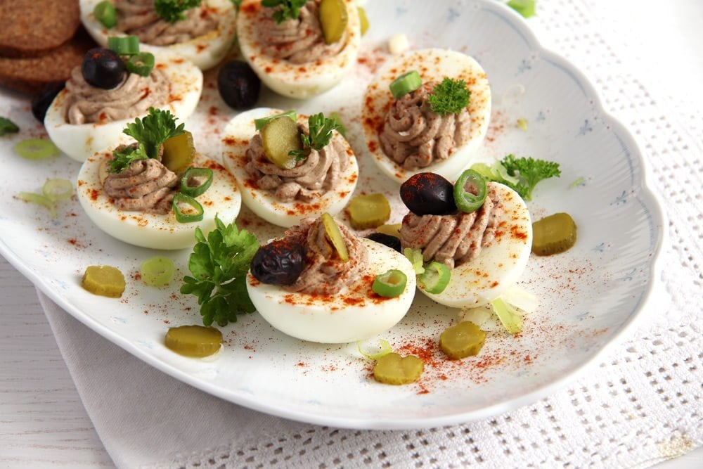 romanian liver eggs with olives and sprinkled with paprika