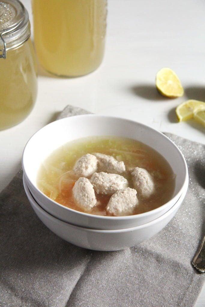 salmon dumplings soup in a white bowl