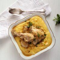 polenta chicken with garlic sauce in a bowl