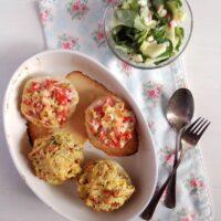bakind dish with stuffed kohlrabi halves and salad on the side