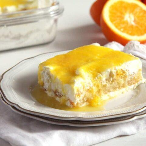 orange tiramisu slice on a plate