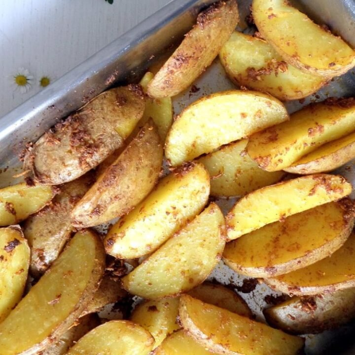 potato wedges in a roasting tin
