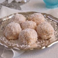 cake balls with coconut and pineapple on a plate