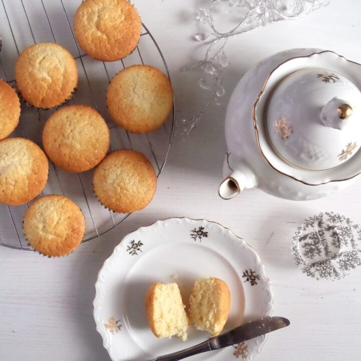 cupcakes and a pot of tea on the table