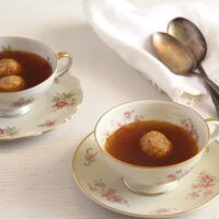 vintage cups filled with roasted vegetable broth.