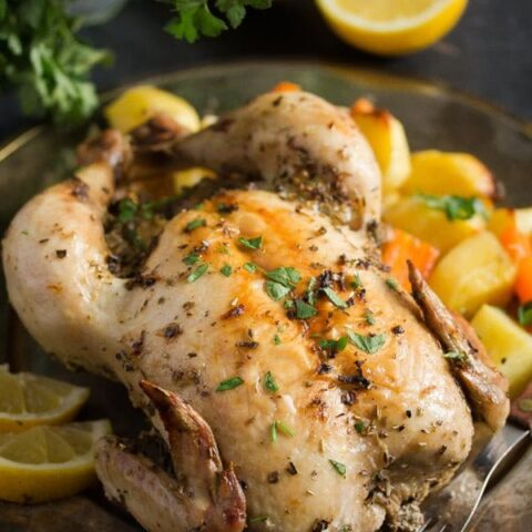 baked lemon chicken served with potatoes and carrots