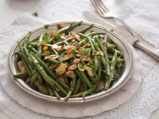 silver plate with green beans almondine