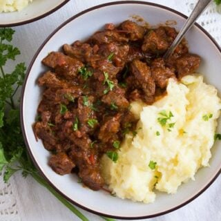 bowl with goulash and mashed potatoes