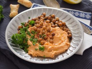 roasted red pepper hummus on silver plate
