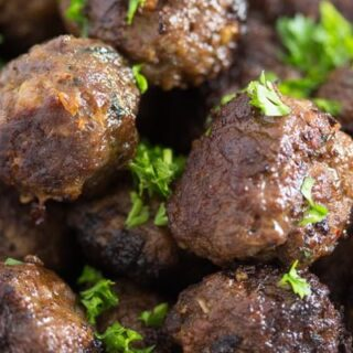 close up of turkish meatballs sprinkled with parsley