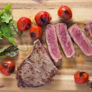 sliced beef steak on a board