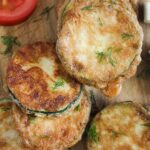 zucchini coins battered in eggs and flour