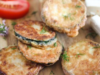 pan fried zucchini slices on a serving board