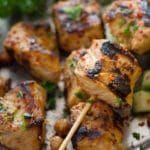 cubes of meat charred on skewers