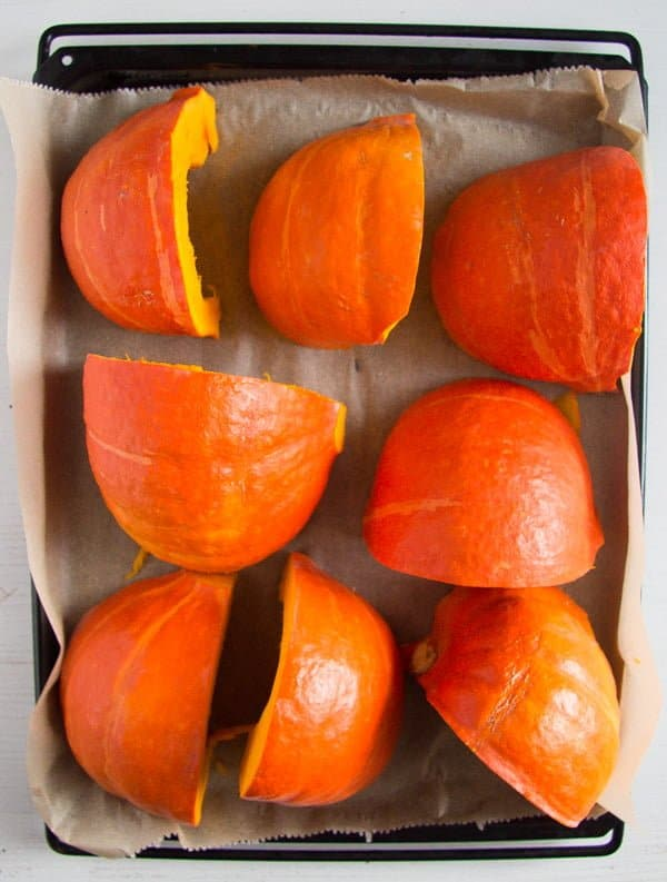 pumpkin pieces on a baking tray