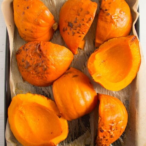 roasted pumpkin pieces on a baking tray