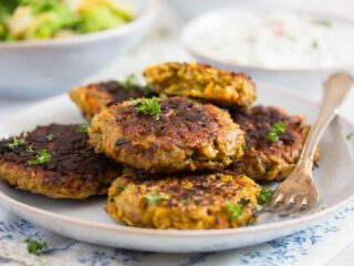 oatmeal patties stacked on a plate with parsley