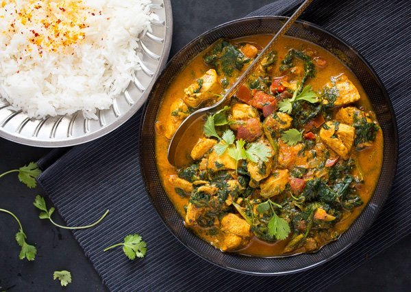serving chicken saag with rice