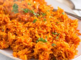 spicy nigerian jollof rice on a serving platter