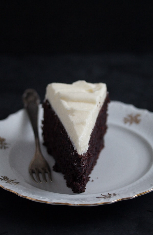 slice of chocolate cake with cream cheese frosting