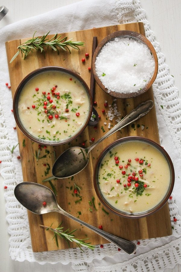 creamy turkey soup with parsley in bowls