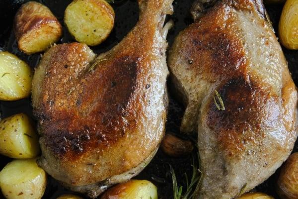 duck confit legs fried in a pan