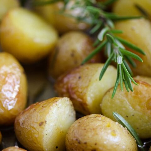 potato confit with rosemary sprig