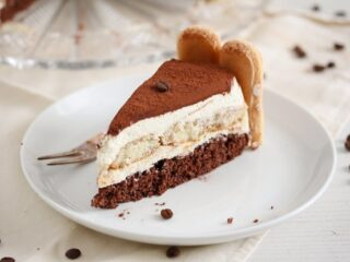 slice of tiramisu torte on a white plate