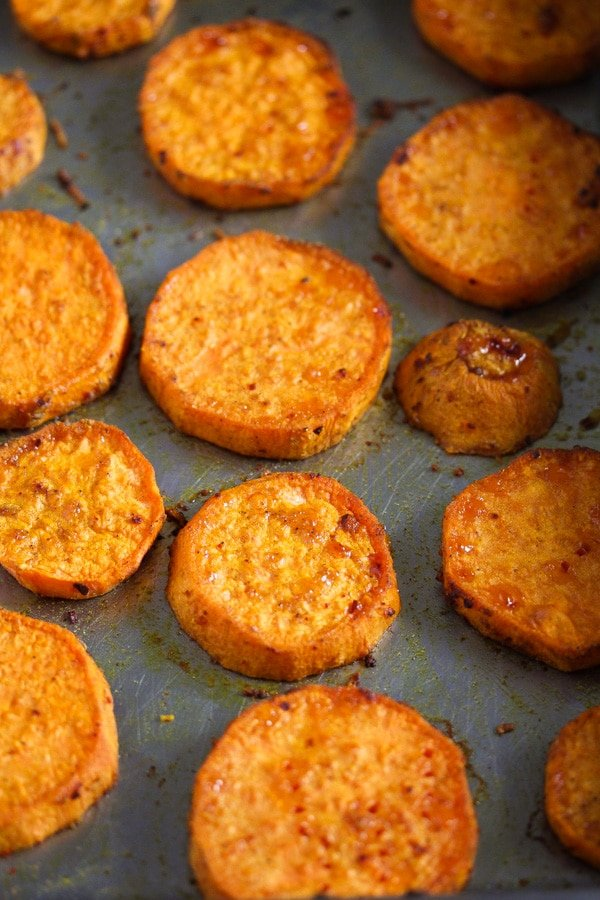 baked sweet potato slices in a roasting tin