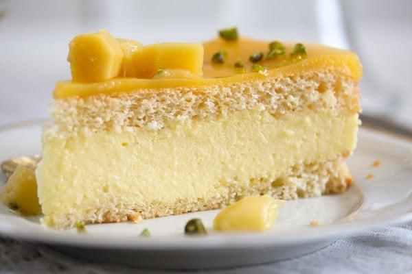 slice of mango cake with fresh mango