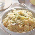 cabbage side dish in a large white bowl