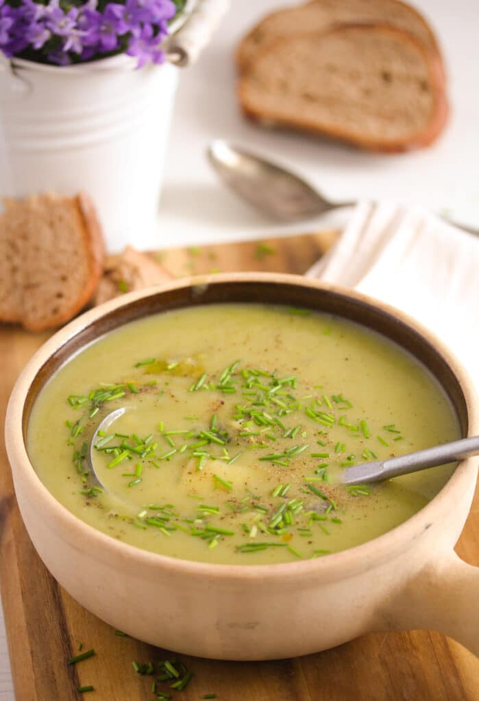 potato soup with leeks in a brown pot