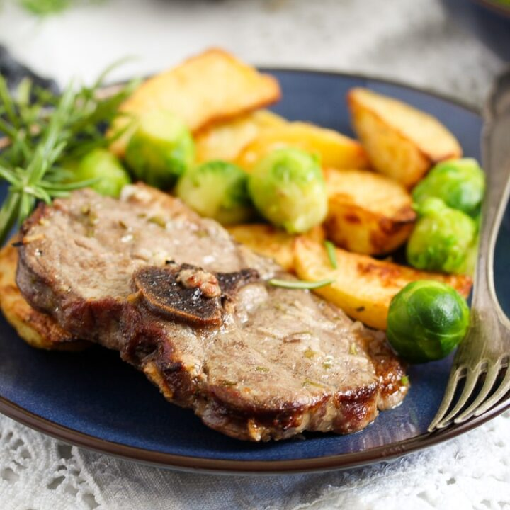 baked lamb chops and potatoes with sprouts