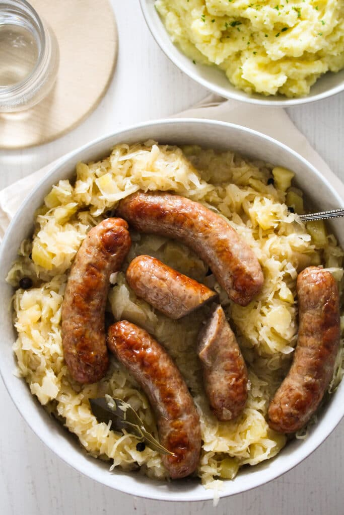 german sausages with sauerkraut in a large bowl