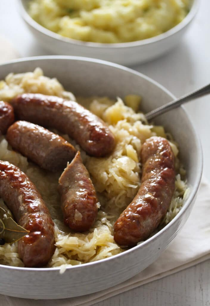 bratwurst cooked in oven and served on sauerkraut