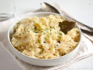 bowl with cooked sauerkraut with bay leaves