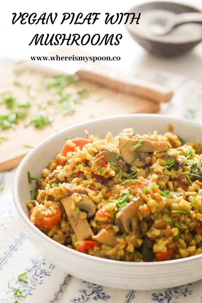 a large white bowl with vegetable pilaf